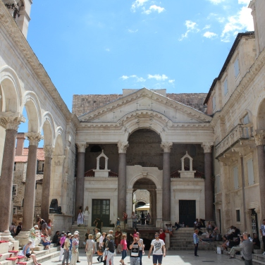 Tourists gather and sip coffee at Diocletian's Palace, Split, Croatia